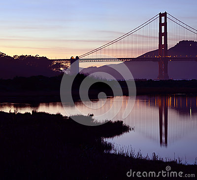 San Francisco s Golden Gate Bridge reflected at dusk