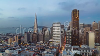 San Francisco skyline and city lights timelapse during sunset. California, USA