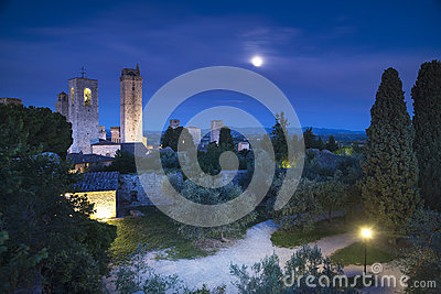San Gimignano night, medieval town landmark in moon light, tower