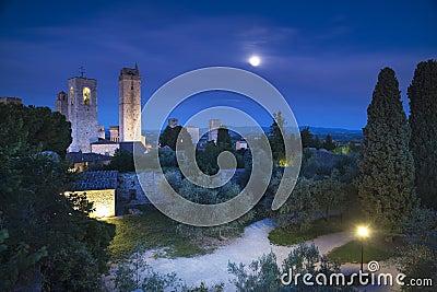 San Gimignano night, medieval town landmark in moon light, tower