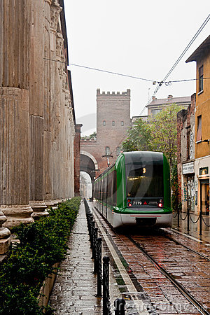 San Lorenzo Columns and Tram Editorial Stock Photo
