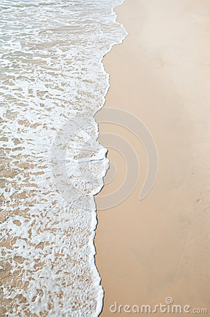 Sand beach and wave sea