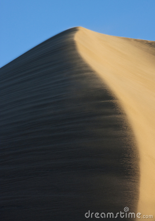 Sand blowing over a sand dune crest - Namibia