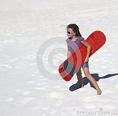 Sand boarding girl