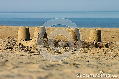 Sand castle on a beach.