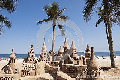 Large sandcastle on beach