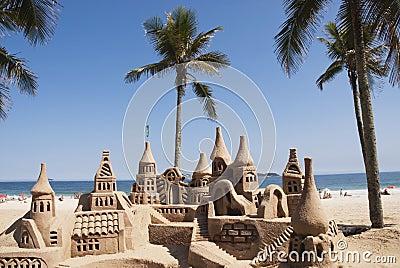Large sandcastle on beach
