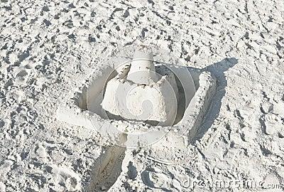 Sand castle on a sunny beach