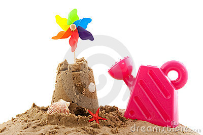 Sand castle and toys at the beach