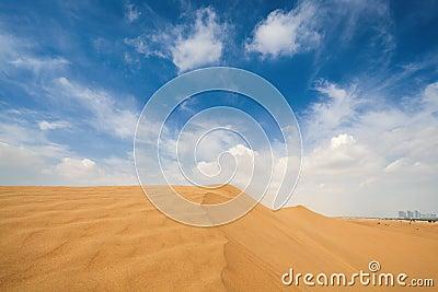 Sand desert and city