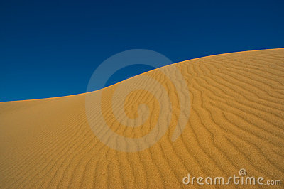 Sand dune against the sky.