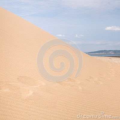 Sand dune with footsteps