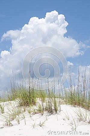 Sand dune under cloud