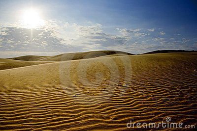 Sand dunes with blue sky