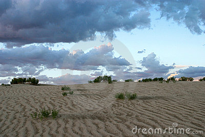 Sand Dunes With Storm Clouds