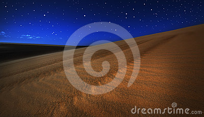 Sand dunes under full moon light and stars
