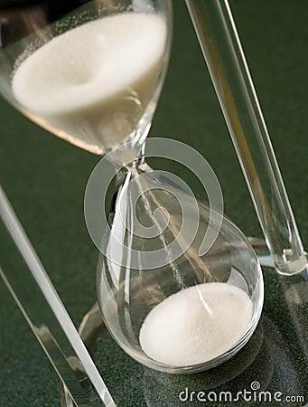 Sand Falls Down Through a Crystal Hour Glass