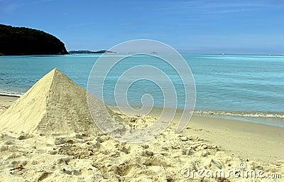 Sand pyramid on beach