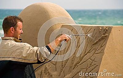 Sand sculptor work on beach