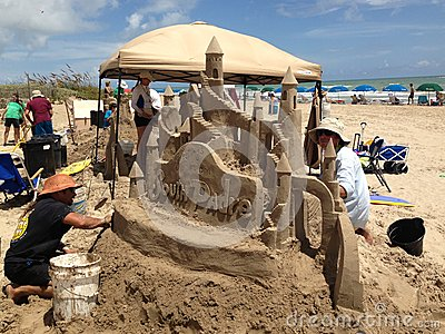 Sand sculptor at work Editorial Stock Photo