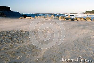 Sand storm on a beach.