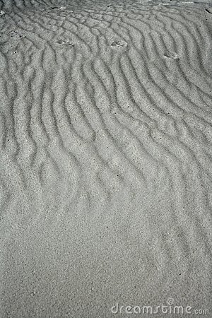 Sand waves texture on white sands like desert