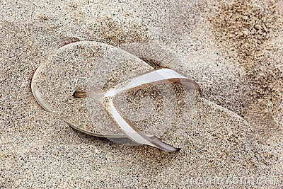 Sandal covered with the sand