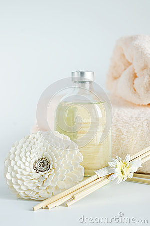 Sandal oil in a bottle and towels for spa