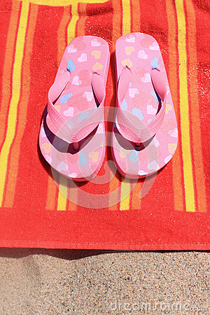 Sandals on beach towel