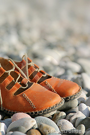 Free Sandals On A Pebbled Beach Stock Photos - 3910383