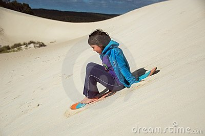 Sandboard surfing