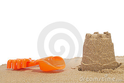 Sandcastle, shovel and rake