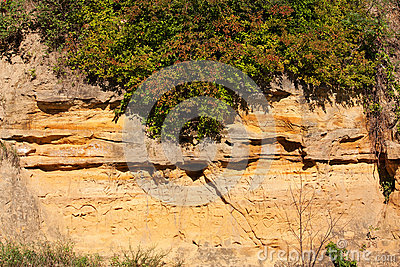 Sandstone cliff face with carvings