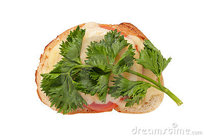 Sandwich with cheese, a tomato and parsley