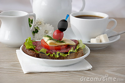 Sandwich with a cup of coffee and milk