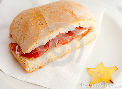 Sandwich with  ham and tomato.