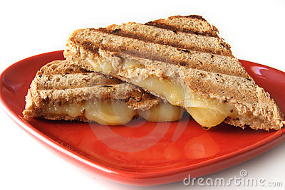 Sandwich with melted cheese on heart shape plate