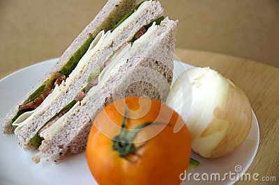 Sandwich on plate with tomato