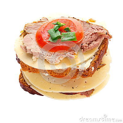 Sandwich with roast pork, cheese and tomato