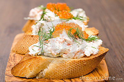 Sandwich with smoked salmon and caviar