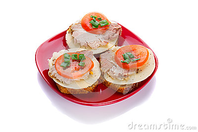 Sandwiches with roast pork, cheese and tomato