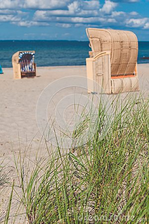Free Sandy Beach And Traditional Wooden Beach Chairs. Northern Germany, On The Coast Of Baltic Sea Royalty Free Stock Images - 101579869