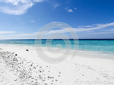 Sandy beach and blue skies