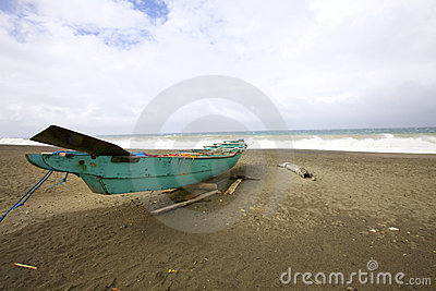 Sandy Beach with Green Boat
