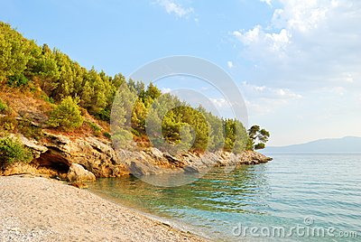 Sandy Beach and Green Hill