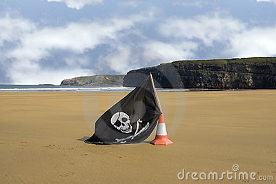Sandy beach with jolly roger flag