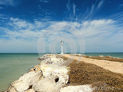 Sandy beach and ocean panorama whith a lighthouse