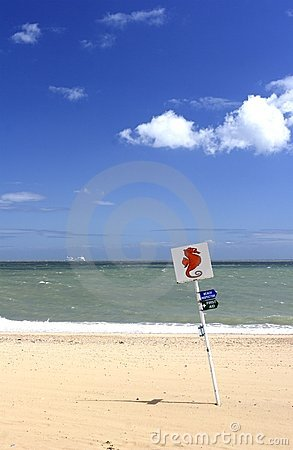 Sandy beach and sign