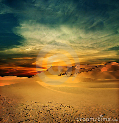 Sandy desert at sunset time