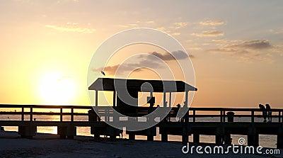 Sanibel island fishing pier at sunset stock photography for Sanibel fishing pier